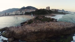 Aerial of tourists on beach and rock near the coastal area Stock Footage
