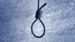 Noose hanging in front of stone wall - stock footage