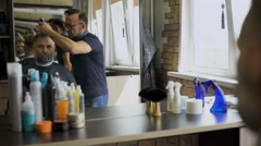 Cozy Barbershop, is engaged in a professional stylist haircut men aged. A - stock footage