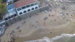 Aerial of tourists relaxing on beach in Arpoador Stock Footage