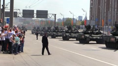 People Welcome Military War Tanks and Trucks ride Moscow street. Parade. Stock Footage