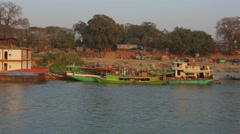 Boat moored on lake, Burma Stock Footage