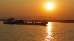 Boat moored on lake in sunset, Burma Stock Footage