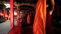 Buddhist monks walking out of monastery at temple, Mustang, Nepal Stock Footage