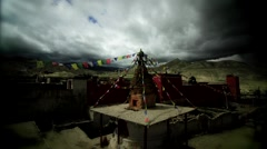 Dark clouds moving over a Monastery in Mustang, Nepal Stock Footage