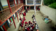 Monks carrying out activities in monastery, Mustang, Nepal - stock footage