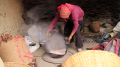 Local woman using a sieve to separate sand from the food grain, Mustang, Nepal Stock Footage
