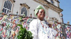 Brazilian man wearing traditional clothes at Bonfim Church Stock Footage