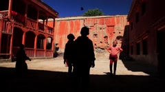 Kid monks playing outside the monastery in Mustang, Nepal Stock Footage