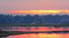 Fisherman working in morning at sunrise,Amarapura, U-Bein bridge, Mandalay, Myan Stock Footage