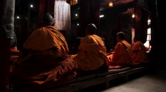 Rear view of Buddhist monks praying in temple Stock Footage