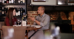 4K Attractive mixed ethnicity couple chatting over drinks in restaurant Stock Footage