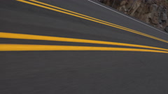 4K Driving POV Two Double Yellow Lines Merge Into One Low Angle Close Up Stock Footage