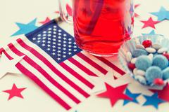 juice glass and american flag on independence day - stock photo