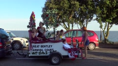 Teenage Beauty Queens Sit Atop a Parade Float - stock footage
