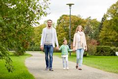 happy family walking in summer park - stock photo