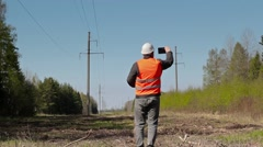 Electrician take pictures on smart phone Stock Footage