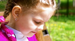 Girl leafing through a book close up Stock Footage
