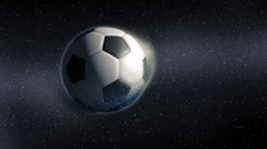 Soccer ball revealing from approaching planet Earth Stock Footage