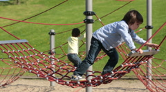 Cute boy, playing on playground, climbing Stock Footage