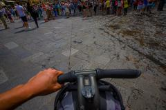 FLORENCE, ITALY - JUNE 12, 2015: Bycicle handlebars with one hand ridding close - stock photo