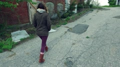 Girl Walking Uphill in an Abandoned Factory Stock Footage