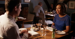4k, A couple on a romantic date at a fine dining restaurant. - stock footage