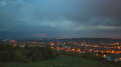 The flow of cloud over the evening city. Time lapse Stock Footage