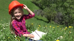 4K Small Engineer In Helmet Writing on Notebook, Portrait of Little Girl Smiling Stock Footage