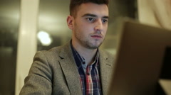 Young businessman working on the laptop. Serious focused sight. Stock Footage