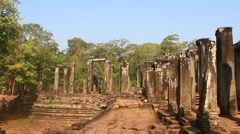 Ancient stone pillar in the temple of Angko in Cambodia Stock Footage