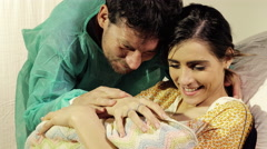 Couple in love in hospital holding new born baby happy Arkistovideo