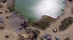 Aerial Drone fly Over open pit sand quarries with small lake Stock Footage