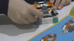 building a LEGO - stock footage