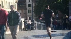 Rome, Italy - ancient bridge Sisto over the Tiber river - street musician - stock footage