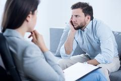 Bored man with depression - stock photo