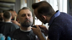Stylish hair salon, barber Empozantny engaged beard respectable businessman Stock Footage