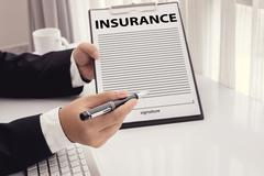 Staff recommended the benefits of insurance coverage Stock Photos