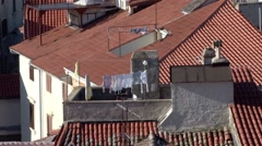 Washing amongst the terracotta tiled rooftops of Piran, Slovenia - stock footage