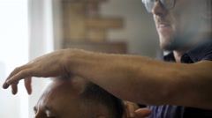 Portrait of stylish barber. Professional filmed on video, while working in his - stock footage