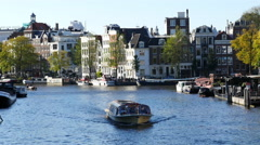 Time Lapse Zoom -  Tour Boats in the Canals - Amsterdam Netherlands Stock Footage