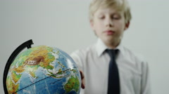 schoolboy rotates the globe - stock footage