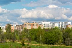 Natural summer landscape with the city in the distance - stock photo