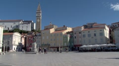 Sunny view of Tartini Square in Piran, with St Georges Church Stock Footage