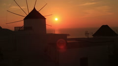 Santorini with famous windmill in Greece, Oia village on beautiful sunset - stock footage