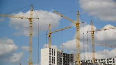 Construction cranes against  sky Stock Footage