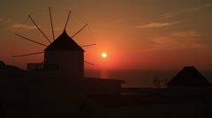 Santorini with famous windmill in Greece, Oia village on beautiful red sunset - stock footage