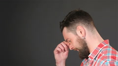 Bearded guy ponders a problem - stock footage