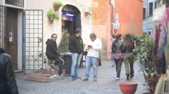 Rome, Italy. Evening in Trastevere, people walk along narrow cozy streets - stock footage