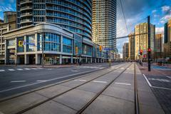 Streetcar tracks and modern buildings along Queens Quay West, at the Harbourf Stock Photos